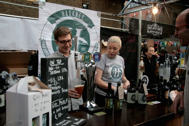 Jack of Hackney Brewery pouring beer during the Saturday Session at London Brewers' Market
